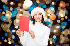 Happy woman with christmas greeting card Stock Photo