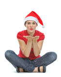 Happy woman with Christmas hat blowing kiss Royalty Free Stock Image