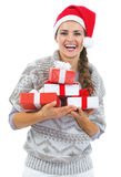 Happy woman in christmas hat with christmas present boxes Stock Photo