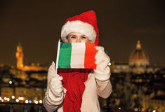 Happy woman in Christmas hat in Florence showing flag Stock Photography