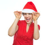 Happy woman in Christmas hat funny posing Royalty Free Stock Photos