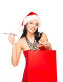 A happy woman in a Christmas hat holding an e-cigarette Royalty Free Stock Image