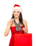 A happy woman in a Christmas hat holding an e-cigarette Royalty Free Stock Images
