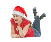 Happy woman with Christmas hat laying on floor Stock Photos