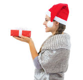 Happy woman in  christmas hat looking on christmas present box Royalty Free Stock Photos