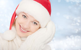 Happy woman in Christmas hat and mittens Royalty Free Stock Photo