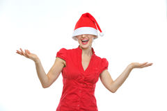 Happy woman with Christmas hat over eyes Stock Image