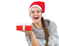 Happy woman in christmas hat showing christmas present box Stock Photography