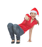 Happy woman in Christmas hat squatted on floor Stock Images