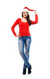Happy woman in a Christmas hat and stylish jeans Stock Images
