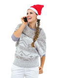 Happy woman in christmas hat talking cell phone Stock Photography