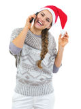 Happy woman in christmas hat talking mobile phone Royalty Free Stock Photo