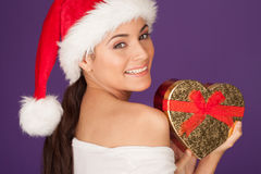 Happy woman with a Christmas heart gift Stock Photography