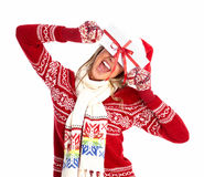 Happy woman with christmas present. Royalty Free Stock Images