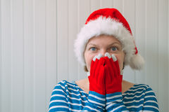 Happy woman with Christmas Santa Claus hat in cheerful mood Royalty Free Stock Photography