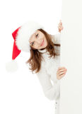 Happy woman in Christmas Santa's hat Royalty Free Stock Photos