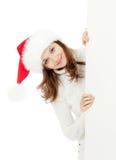 Happy woman in Christmas Santa's hat Royalty Free Stock Photos