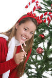 Happy woman by Christmas tree Stock Image
