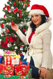 Happy woman  by Christmas tree with gifts Stock Photography