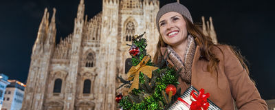 Happy woman with Christmas tree in Milan looking into distance Royalty Free Stock Photo