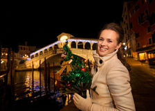 Happy woman with Christmas tree near Rialto Bridge in Venice Stock Photos