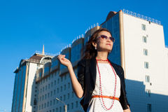 Happy woman on city street royalty free stock images