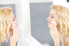 Happy woman cleaning face Royalty Free Stock Image