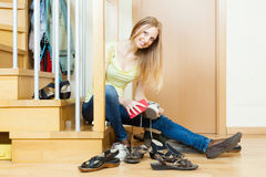 Happy woman cleaning footwear Stock Photos