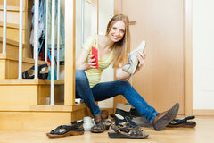 Happy woman cleaning footwear Royalty Free Stock Photo