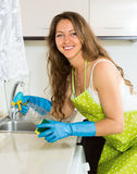 Happy woman cleaning  furniture in kitchen Stock Image