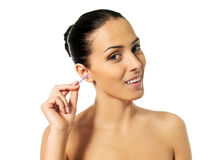 Happy woman cleaning her ear Royalty Free Stock Photo