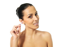 Happy woman cleaning her ear Royalty Free Stock Photography