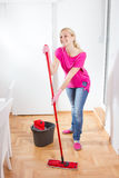 Happy Woman Cleaning Home Stock Image
