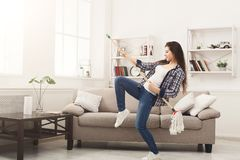 Happy woman cleaning home with mop and having fun Royalty Free Stock Photography