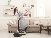 Happy woman cleaning home with vacuum cleaner stock photos
