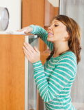 Happy woman cleaning wooden furiture Stock Photos