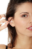 Happy woman cleans her ear Royalty Free Stock Photography