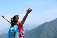 Happy woman climber mountain peak. Hiking woman climber open arms mountain peak Royalty Free Stock Photography