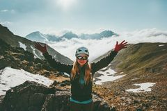 Happy Woman climber on summit mountain. Travel healthy lifestyle adventure concept active summer vacations outdoor sport girl wearing helmet gear raised hands Stock Images