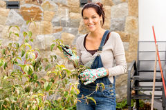Happy woman clipping bush garden hobby clippers. Happy woman clipping bush clippers garden yard hobby housework Royalty Free Stock Photography