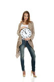 Happy woman with clock. Stock Images