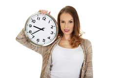 Happy woman with clock. Stock Photos