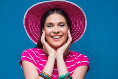 Happy woman close up portrait with pink beach hat Royalty Free Stock Photo