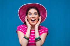 Happy woman close up portrait with pink beach hat Stock Images