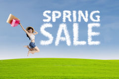 Happy woman with cloud of spring sale Royalty Free Stock Photos