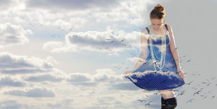 Happy woman in the clouds Royalty Free Stock Images