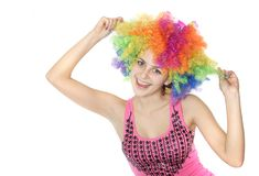 Happy woman in clownish wig over white Royalty Free Stock Photos