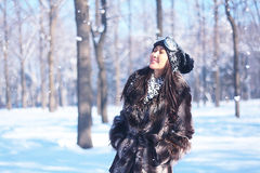 Happy woman in coat,  winter wood with snow Royalty Free Stock Image