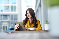 Happy woman with cocoa and tablet pc at city cafe Royalty Free Stock Photo
