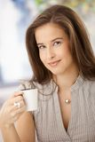 Happy woman with coffee Royalty Free Stock Images